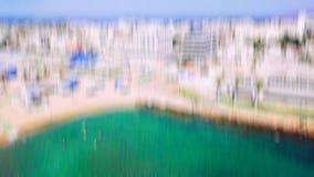 Flyg- sikt till staden av Nahariya, Israel Abstrakt effekt för rörelsesuddighet Arkivfoto