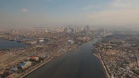 Flyg- stad med skyskrapor och byggnader Filippinerna Manila, Makati royaltyfri foto