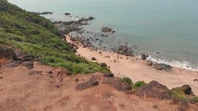 Flyg- strand för surrsiktsCola i tillståndet av GOA i Indien arkivfilmer
