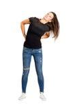 Flyga den unga kvinnan för lång hårbrunett som skakar huvudet Arkivfoto