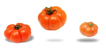 Flyga för tre tomater Royaltyfria Bilder