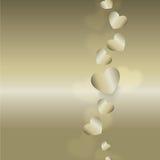 Flyga guld- hjärtor Royaltyfri Bild