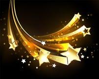 Flyga guld- kometguldstjärnor stock illustrationer