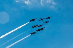 Flyga i bildande på airshow Fotografering för Bildbyråer