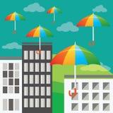 Flyga kulöra paraplyer Arkivbild