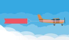 Flygadvertizingbaner som dras av ljusnivån Arkivbild