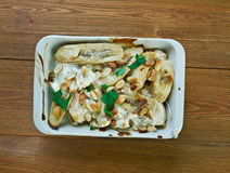 Flygande Jacob. Swedish casserole that consists of chicken, cream, chili sauce, bananas, roasted peanuts and bacon Stock Image