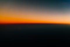 Flygbild av havsolnedgången Arkivbilder