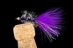 Flyger den färgrika handen bundet fiske visat på Champagne Cork 7 royaltyfria foton