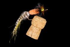 Flyger den färgrika handen bundet fiske visat på Champagne Cork 3 royaltyfri fotografi