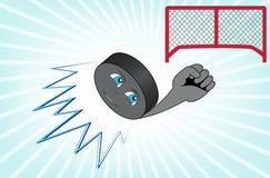 Flyget för hockeypuck in i målet. Arkivfoton