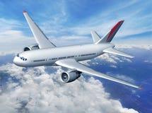 Flygplan över molnen Royaltyfria Bilder