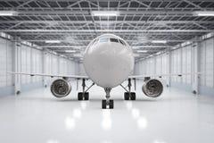 Flygplan i hangar Fotografering för Bildbyråer
