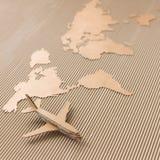 Flygplan och världen kartlägger Arkivfoto
