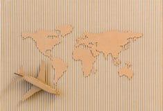 Flygplan och världskarta Royaltyfri Fotografi