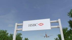 Flygplan som flyger över advertizingaffischtavlan med den HSBC logoen Redaktörs- tolkning 3D Arkivbild