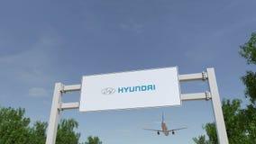 Flygplan som flyger över advertizingaffischtavlan med den Hyundai Motor Company logoen Redaktörs- tolkning 3D Arkivbilder