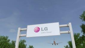 Flygplan som flyger över advertizingaffischtavlan med den LG Korporation logoen Redaktörs- tolkning 3D Arkivfoton