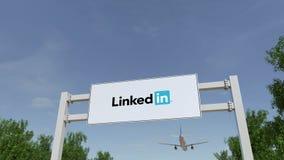 Flygplan som flyger över advertizingaffischtavlan med den LinkedIn logoen Redaktörs- tolkning 3D Arkivbild