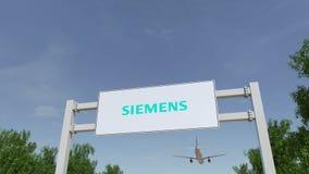 Flygplan som flyger över advertizingaffischtavlan med den Siemens logoen Redaktörs- tolkning 3D Royaltyfri Foto