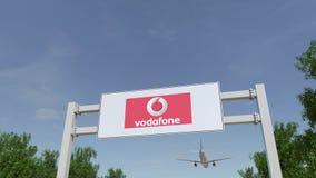 Flygplan som flyger över advertizingaffischtavlan med den Vodafone logoen Redaktörs- tolkning 3D Royaltyfria Bilder