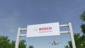 Flygplan som flyger över advertizingaffischtavlan med Robert Bosch den GmbH logoen Redaktörs- tolkning 3D Royaltyfri Bild