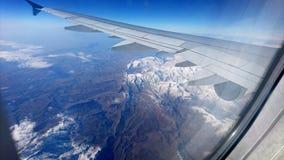 Flygplanfönstersikt Arkivfoto
