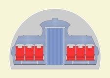 Flygplankabin med passagerareplatser Arkivfoto