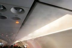 Flygplankabin med skillnader för dunstkondensation tack vare av tem arkivfoto