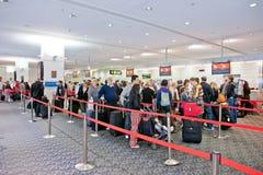 Flygplatsincheckningbehandling Arkivfoto