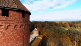 Flyin near Ruins of Turaida castle tower on springtime, Sigulda, Latvia. Flying around Ruins of Turaida castle on springtime, Sigulda, Latvia stock video footage
