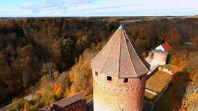 Flyin over Ruins of Turaida castle tower on springtime, Sigulda, Latvia. Flying around Ruins of Turaida castle on springtime, Sigulda, Latvia stock footage