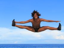 Flying. Asian male performing cheer-dance jump at the beach of the marine sanctuary of Apo Islands, Negros Oriental, Philippines Royalty Free Stock Photos