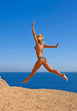 Flying. Nice woman jump on the Edge of Blue Hole Stock Images