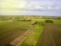 Flying above agricultural fields. Late afternoon fying above agricultural fields near small town Stock Images