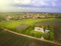 Flying above agricultural fields. Late afternoon fying above agricultural fields near small town Stock Image