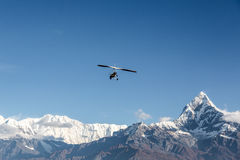 Flying above the Annapurna mountain range in Nepal Stock Photos