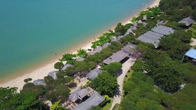 Flying above the beach, over the jungle and blue ocean Aerial view of beautiful beach stock footage