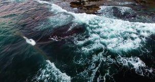 Flying above beautiful wavy seashore at evenng stock video