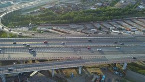 Flying above car traffic on highway. Aerial view of car traffic on highway stock footage