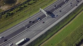 Flying above car traffic on highway. Aerial view of car traffic on highway stock video footage