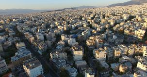 Above City 6. Flying above a city full of buildings and apartment blocks stock footage