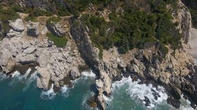 Above the Cliffs of a Rocky Bay. Flying above the cliffs of a rocky bay stock video footage