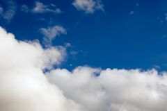 Flying Above the Clouds. A jet airliner flying in the blue sky above the clouds Stock Images