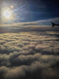 Flying above the clouds. In aeroplane on way to Tasmania royalty free stock images