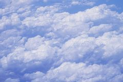 Flying above the clouds at 30,000 ft Stock Image