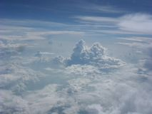 Flying above the clouds. Homecoming. Ten hours in the air. Beautiful clouds. stock photos