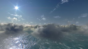 Flying above clouds and ocean stock video