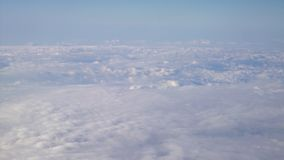 Flying above the clouds. Sunny view from the airplane, soft focus.  stock video
