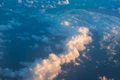 Flying above the clouds. Aerial view from the airplane royalty free stock images